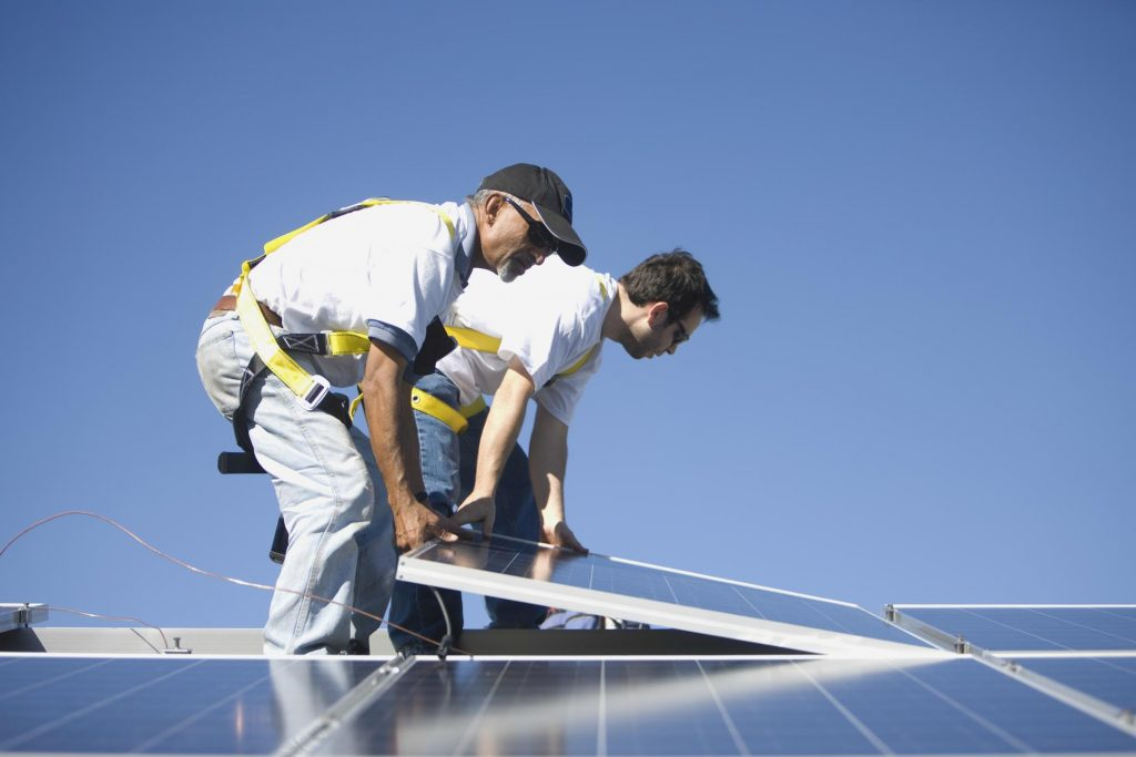men putting the solar