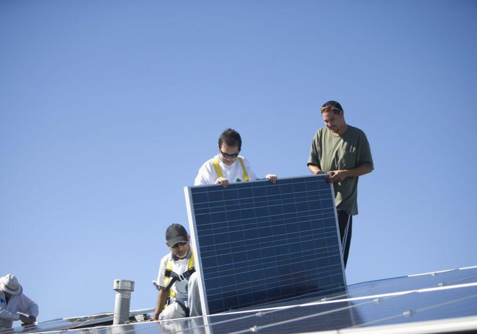 men installing a solar