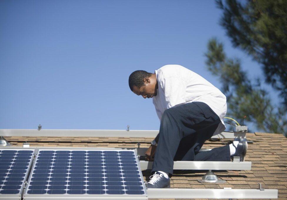 man installing a solar